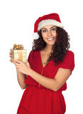 Pretty woman in Christmas with a gift Stock Image