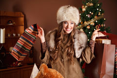 Pretty woman with Christmas gifts Royalty Free Stock Photos