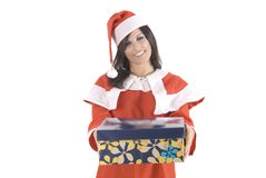 A pretty woman at Christmas holding a gift box Stock Photography