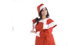 Pretty woman at Christmas holding a sign Royalty Free Stock Image