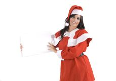 A pretty woman at Christmas holding a sign Royalty Free Stock Image