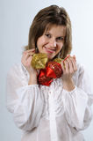 Pretty woman with Christmas ornaments Royalty Free Stock Images