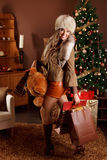 Pretty woman with Christmas presents Stock Photos
