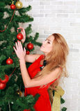 Pretty woman with christmas tree Stock Image