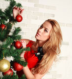 Pretty woman with christmas tree Stock Photography
