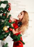 Pretty woman with christmas tree Royalty Free Stock Images