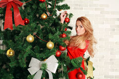Pretty woman with christmas tree Royalty Free Stock Photos