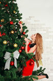 Pretty woman with christmas tree Royalty Free Stock Image