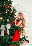 Pretty woman with christmas tree Stock Photos