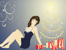 Pretty woman and a christmastree Stock Images