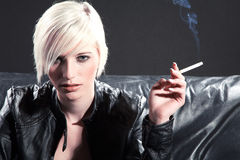 Pretty woman with cigarette Royalty Free Stock Image