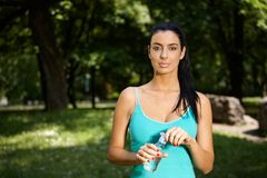 Pretty woman in city park drinking water Royalty Free Stock Photos