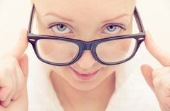 Pretty woman with classy glasses Stock Image