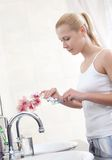 Pretty woman cleans her teeth Stock Image