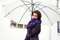 Pretty woman in cloak under white umbrella Royalty Free Stock Photography