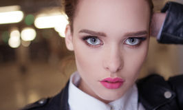 Pretty woman close-up with blue eyes and full lips Royalty Free Stock Photos