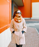Pretty woman in coat in the city, street fashion Royalty Free Stock Image