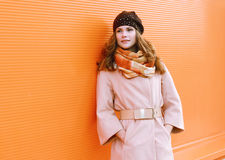 Pretty woman in coat Stock Images