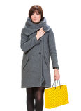 Pretty woman in coat with shopping bags Stock Images
