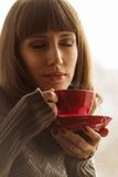 Pretty Woman with Coffee near Window Royalty Free Stock Photos