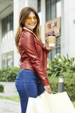 Pretty woman with coffee and paper-bags royalty free stock photo