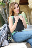 Pretty Woman on College Campus Royalty Free Stock Photos