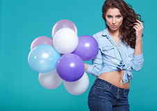 Pretty woman with colored balloons Royalty Free Stock Images