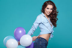 Pretty woman with colored balloons Royalty Free Stock Photo
