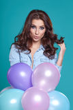 Pretty woman with colored balloons Stock Images