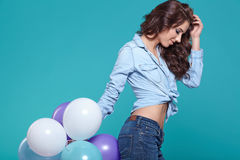 Pretty woman with colored balloons Stock Photography