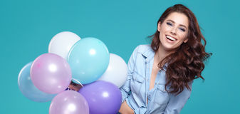 Pretty woman with colored balloons Stock Photo