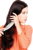 Pretty woman combing hair Royalty Free Stock Photo