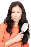 Pretty woman combing her long black hair Royalty Free Stock Image