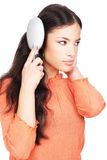 Pretty woman combing her long black hair Stock Photo