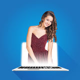 Pretty woman coming out of laptop computer Stock Photography