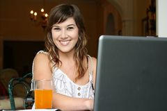 Pretty Woman at Computer Royalty Free Stock Images