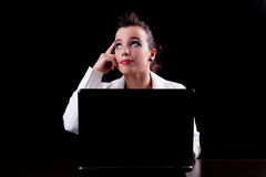 Pretty woman on the computer, thinking looking up Royalty Free Stock Photo