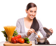 Pretty woman is cooking on the kitchen Royalty Free Stock Image