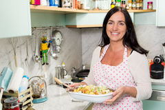 Pretty woman cooking Royalty Free Stock Image