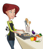 Pretty woman cooking a meal. With vegetable, in the kitchen Royalty Free Stock Image