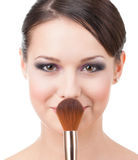 Pretty woman with cosmetic brush. For powder, isolated on white Royalty Free Stock Photos