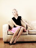 Pretty woman on couch Royalty Free Stock Photo