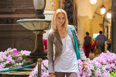 Pretty woman in the courtyard of Palazzo Vecchio . Florence Royalty Free Stock Images