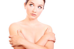 Pretty woman covering her breasts Stock Image