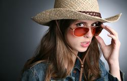 Pretty woman in the cowboy hat Stock Photos