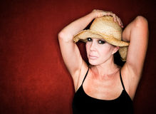 Pretty woman in a cowboy hat Royalty Free Stock Images