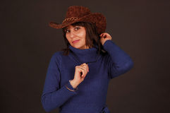 Pretty woman with cowboy hat Stock Photos