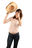 Pretty woman with cowboy hat Stock Images