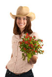 Pretty woman with cowboy hat and flowers Royalty Free Stock Photo