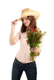 Pretty woman with cowboy hat and flowers Stock Photos
